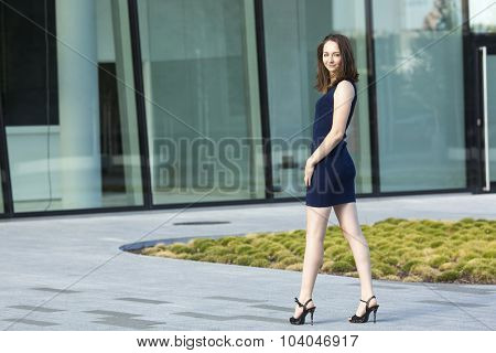 Fashionable young attractive woman standing near the business center.