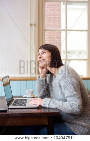 Woman With Laptop Daydreaming