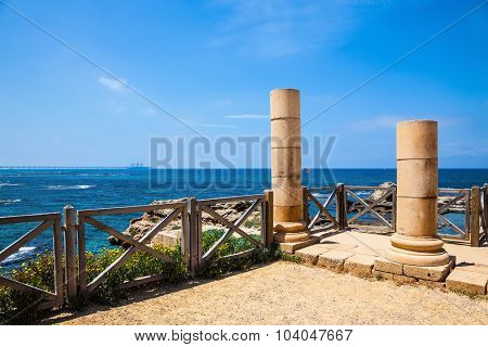 Ancient columns from the Roman period on the Mediterranean coast. National Park Caesarea, Israel