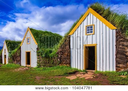 Houses are roofed by the turf and grass. The recreated village -  museum of first settlers in Iceland.  Village of ancestors
