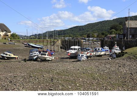 Boats At Low Tide In A Harbour