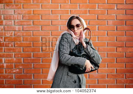 girl in a coat on the street