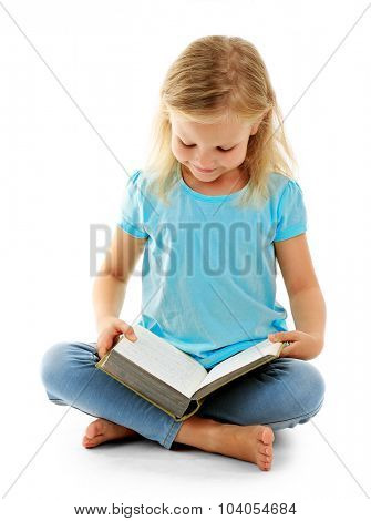 Beautiful little girl with book, isolated on white