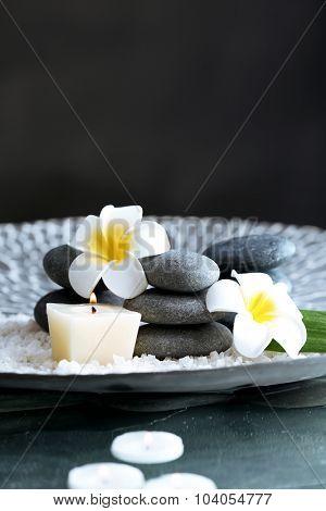 Still life with spa stones on dark background