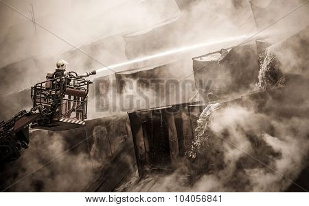Fireman And Burnt Roof
