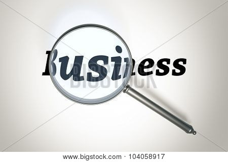 An image of a magnifying glass and the word business
