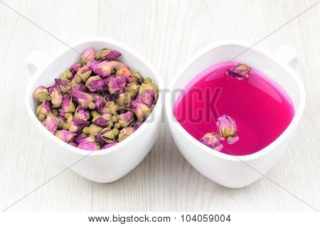 Two White Cups Of Tea Roses On A Wooden Table