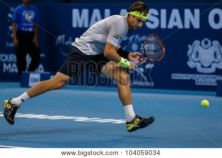 KUALA LUMPUR, MALAYSIA - OCTOBER 01, 2015: David Ferrer of Spain chases a backhand return in his match at the Malaysian Open 2015 Tennis tournament held at the Putra Stadium, Malaysia.