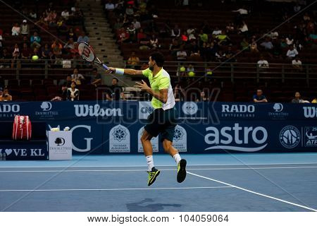 KUALA LUMPUR, MALAYSIA - OCTOBER 01, 2015:Grigor Dimitrov of Bulgaria hits a forehand volley in his match at the Malaysian Open 2015 Tennis tournament held at the Putra Stadium, Malaysia.