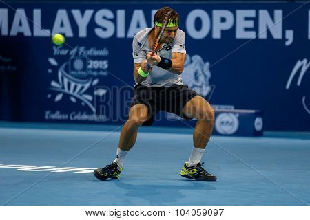 KUALA LUMPUR, MALAYSIA - OCTOBER 01, 2015: David Ferrer of Spain hits a backhand return in his match at the Malaysian Open 2015 Tennis tournament held at the Putra Stadium, Malaysia.