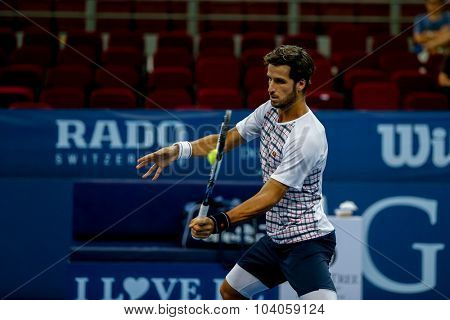 KUALA LUMPUR, MALAYSIA - OCTOBER 01, 2015: Feliciano Lopez of Spain plays a forehand volley during his match at the Malaysian Open 2015 Tennis tournament held at the Putra Stadium, Malaysia.