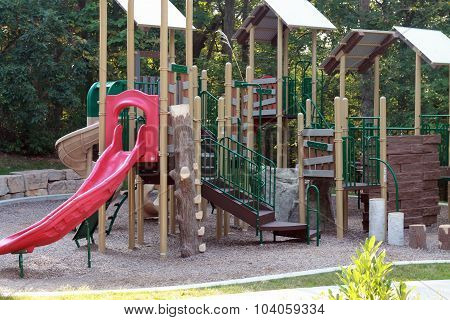 Playground equipment with red slide