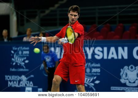 KUALA LUMPUR, MALAYSIA - OCTOBER 01, 2015: Mischa Zverev of Germany attempts a forehand return during his match at the Malaysian Open 2015 Tennis tournament held at the Putra Stadium, Malaysia.