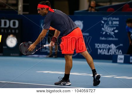 KUALA LUMPUR, MALAYSIA - OCTOBER 01, 2015: Marcos Baghdatis of Cyprus prepares to serve during his match at the Malaysian Open 2015 Tennis tournament held at the Putra Stadium, Malaysia.