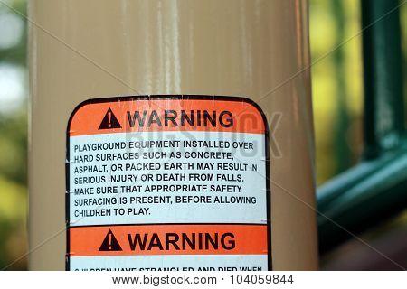 Warning sign on playground equipment