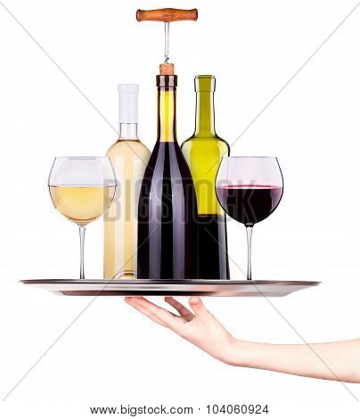 Waitress holding tray with glasses and  bottles