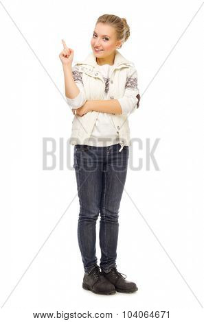Young smiling girl shows pointing gesture isolated