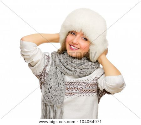 Young smiling girl with fur hat isolated