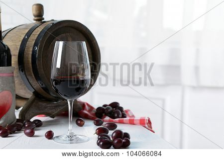 Beautiful still life with wine and grape on table