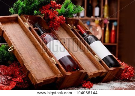 Wine bottles in decorated wooden boxes at the shop