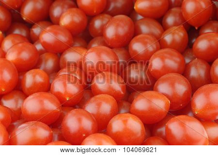 fresh Tomberry (very small) tomatoes background