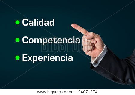 Business Man Pointing At The Words -quality, Competence, Experience
