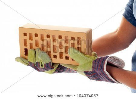 Facing brick in hand with the construction glove isolated on white background