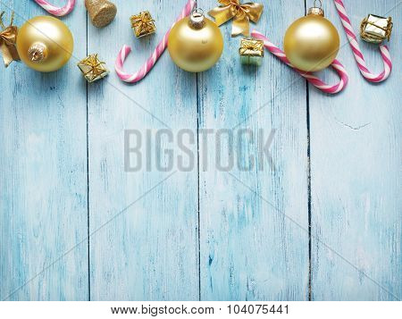 Candy canes on blue wooden background.