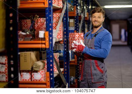 Worker on a automotive spare parts warehouse