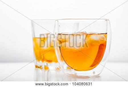 Whiskey on the rocks in an old fashion glass.