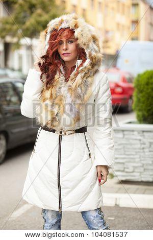 Beautiful Fashion Model In Fur Coat On Street