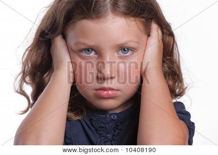 Sad Girl Covering Ears