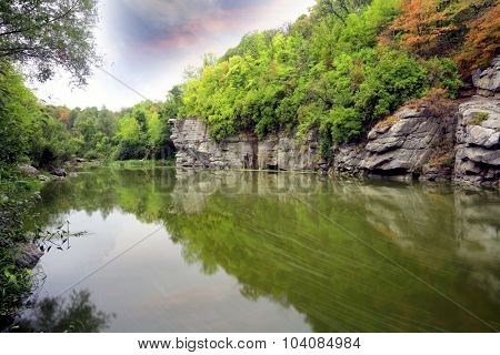 Landscape with rocks over river in deep green forest