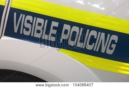 Visible policing logo on police car