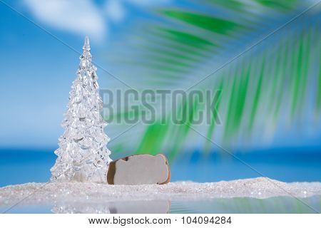 glass christmas tree  ball on  beach with seascape background