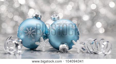 Blue Christmas balls with decoration on shiny background