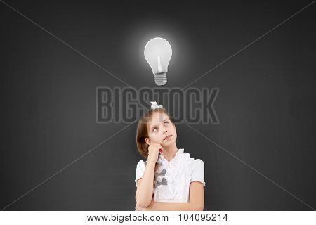 Cute thoughtful school girl and light bulb above her head