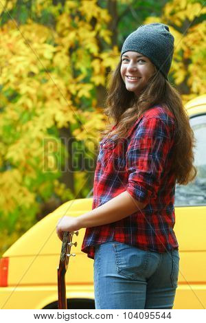 Close Up Of Turning Around Guitar Player Girl Wearing Slouchy Beanie Hat At Yellow Van Background