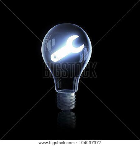 Light bulb glowing icon on dark background