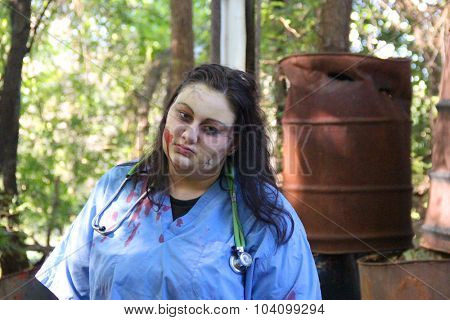MUSKOGEE, OK - Sept. 12: An actor dressed as a zombie waits for athletes during the Castle Zombie Run at the Castle of Muskogee in Muskogee, OK on September 12, 2015.