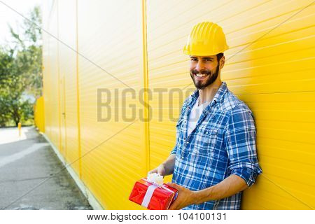 Worker With A Gift In Hands