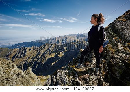 Woman Hiker On A Trail