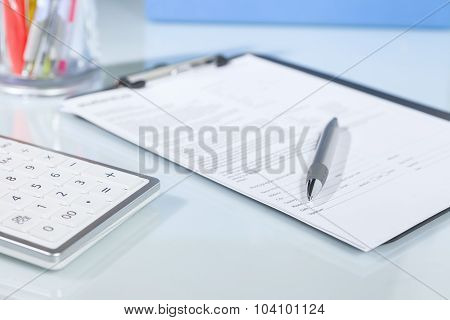 Calculator, Pen And Documents On A Desk