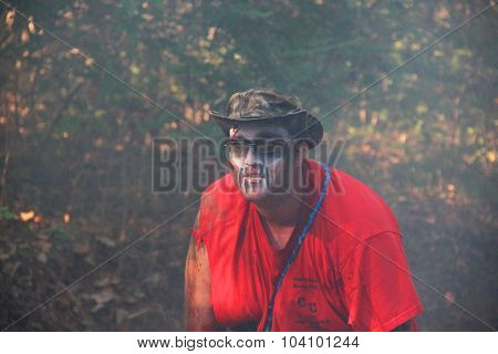 MUSKOGEE, OK - Sept. 12: A man dressed as a zombie waits for runners during the Castle Zombie Run at the Castle of Muskogee in Muskogee, OK on September 12, 2015.