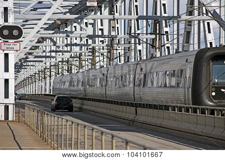 Train And Cars On Bridge