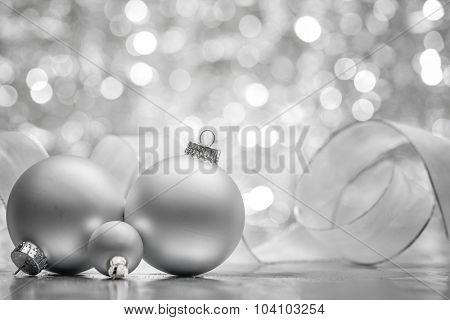 Silver Christmas balls on shiny background