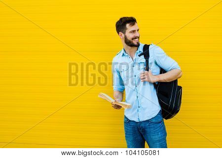 Handsome Man With Backpack On Yellow