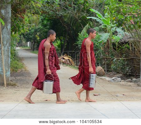 Burmese Monks Walking Morning Alms