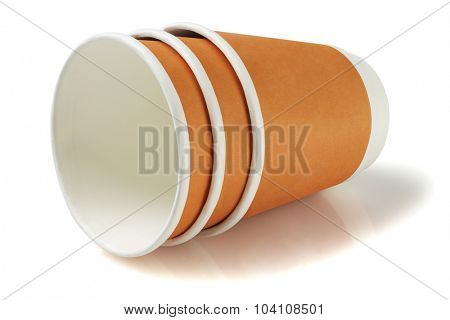 Disposable Paper Coffee Cups Lying on White Background