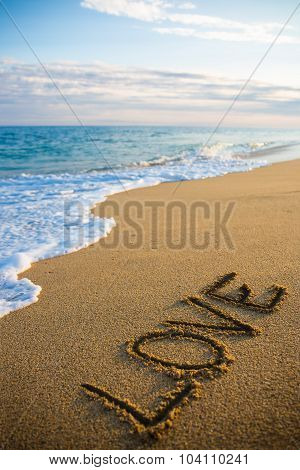 Beach Background With Word Love Written In Sand